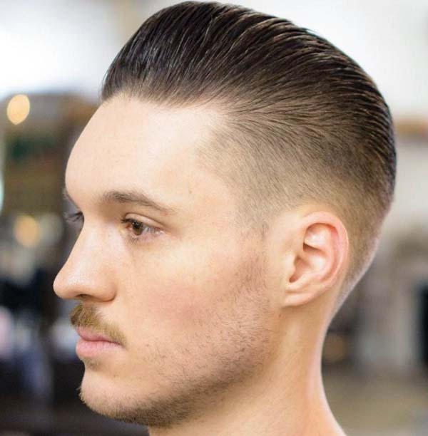 All around Taper Fade Haircut Brushed Back