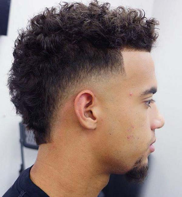 Curly Taper Fade Mohawk Haircut